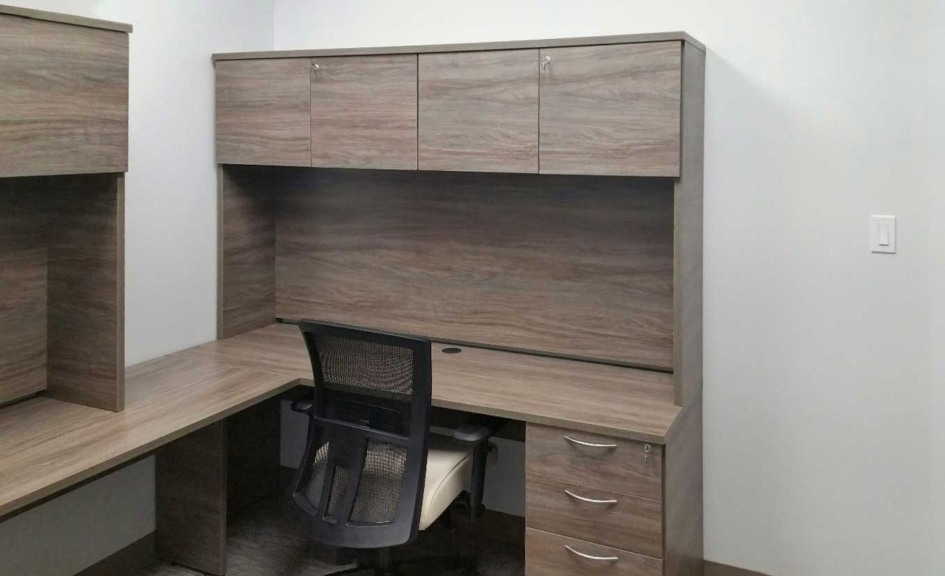 Hutch L-Desk with Mixed Storage placed against the wall, office chair