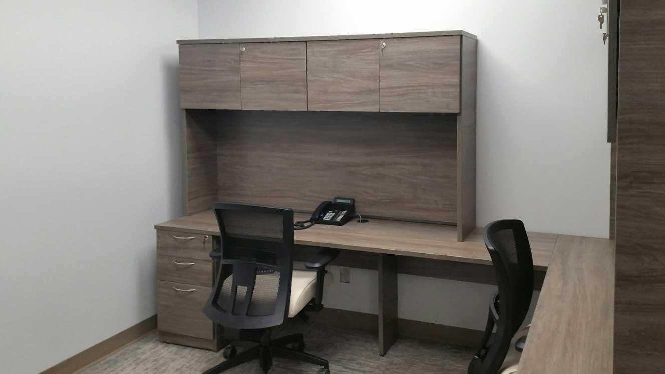 Hutch Desk with Mixed Storage placed against the wall, office chair