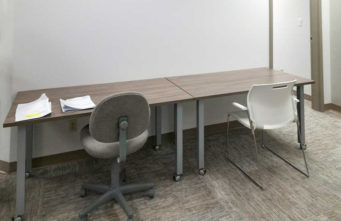 Desk with legs placed against the wall, chairs
