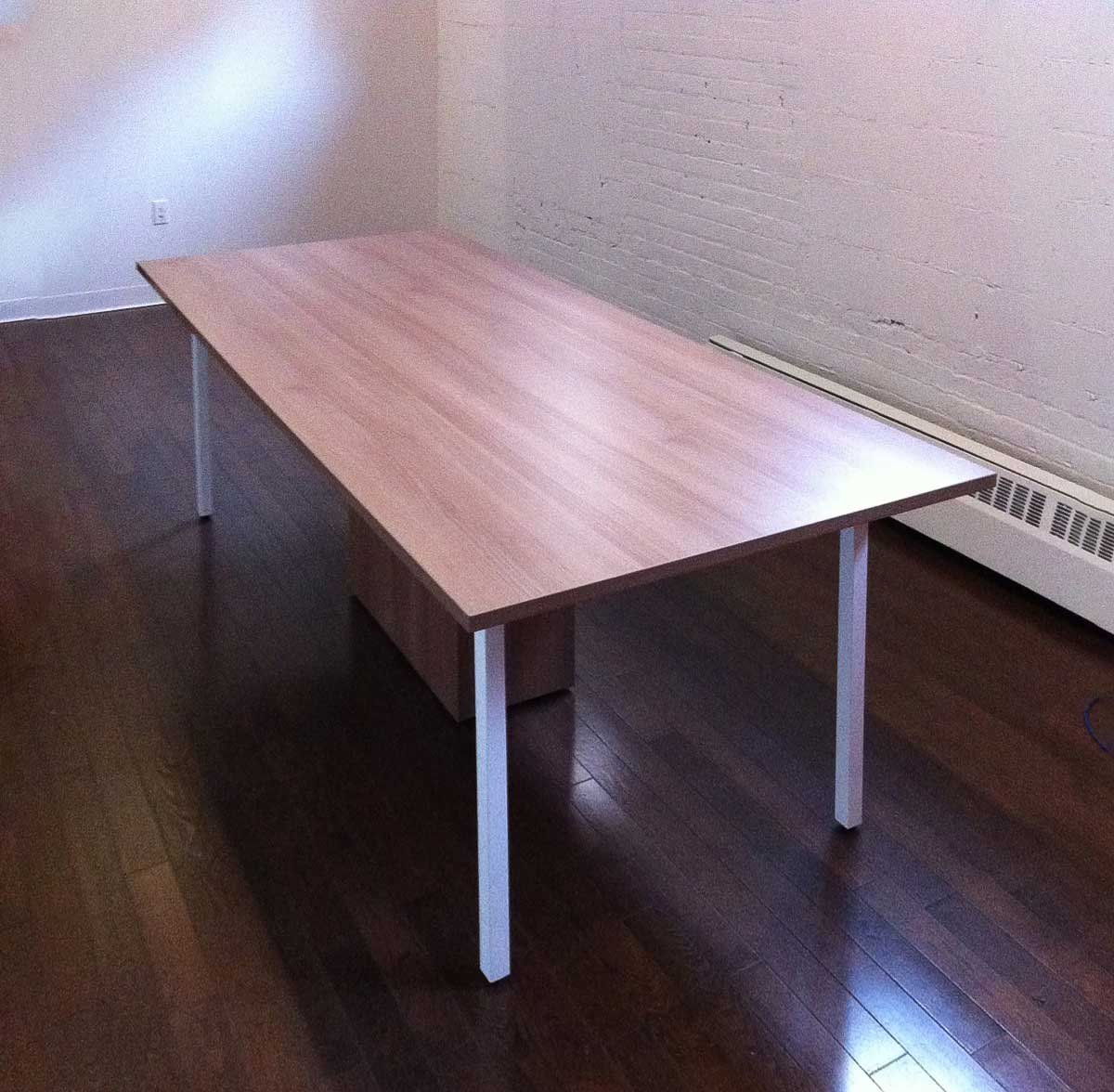 Meeting Table with white Legs in an empty room