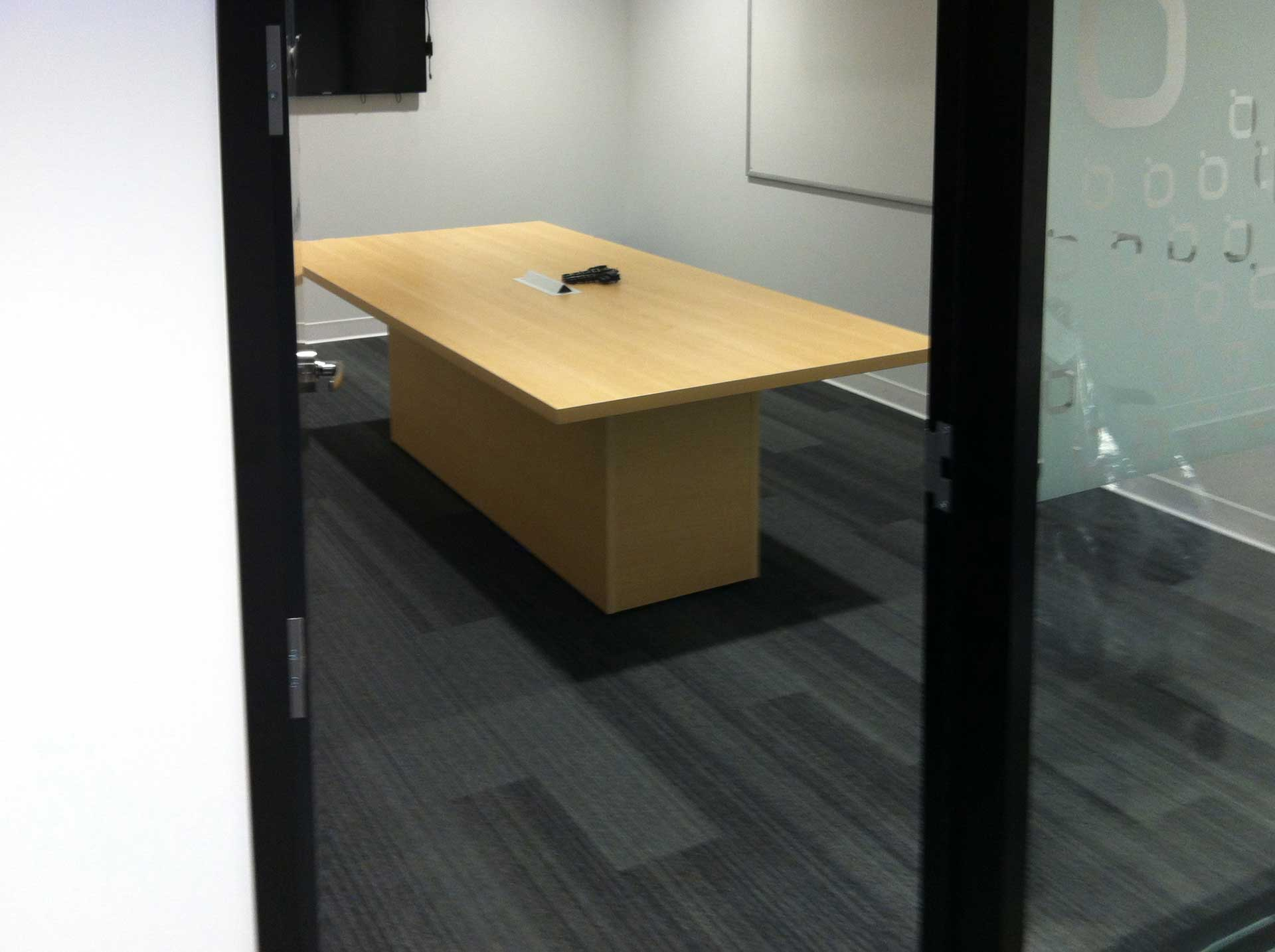 Meeting Table with box behind the glass wall