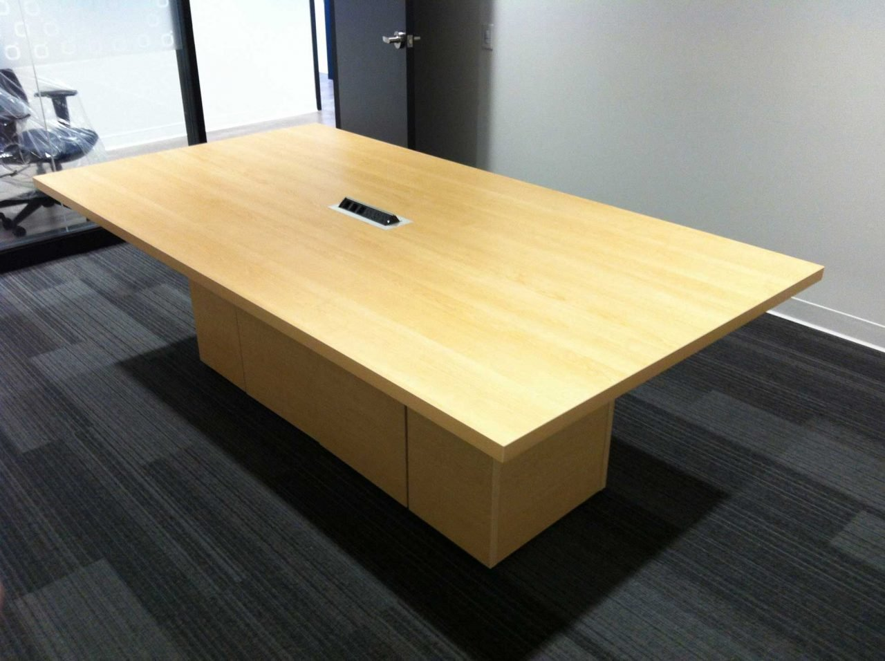 Meeting Table with box in an empty room