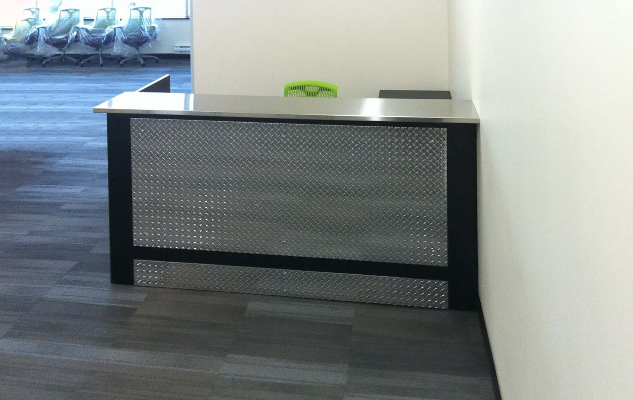Custom Reception with metal plate, chair