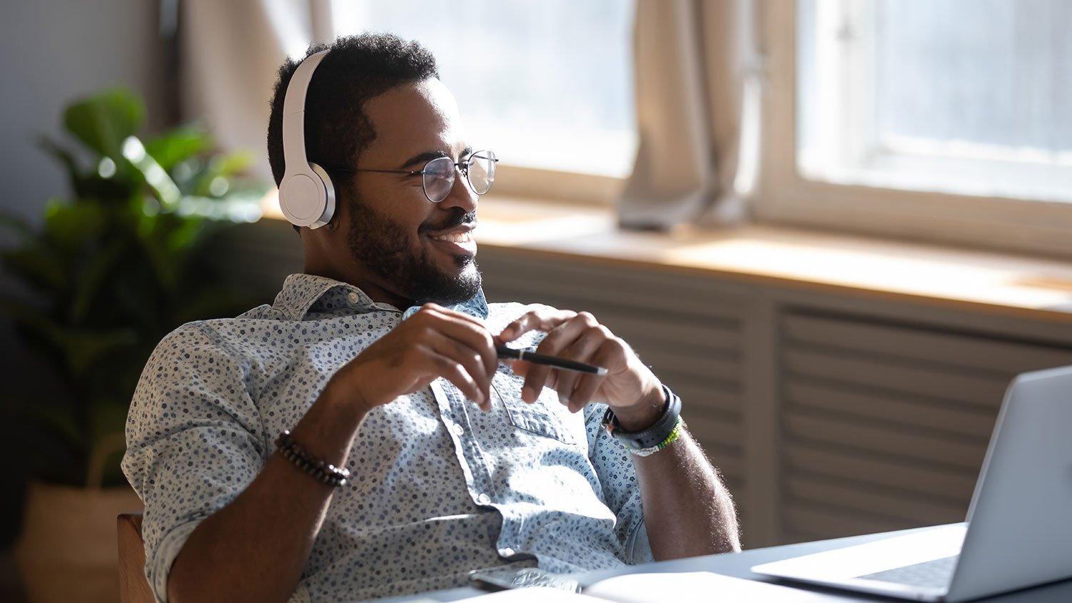 Happy worker with wireless headphones