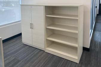 Cabinet with doors and an open cabinet